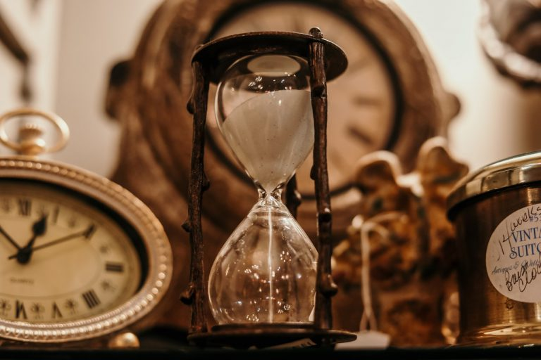 an hourglass and various clocks