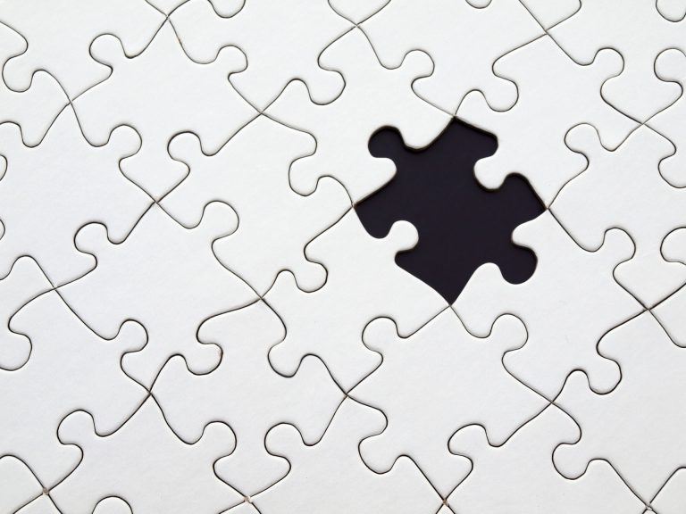 A puzzle with one piece missing